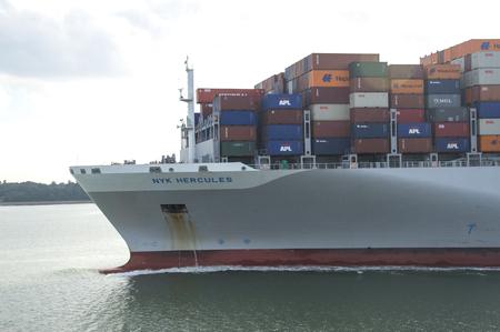 SOUTHAMPTON, UK - JULY 11, 2014 - NYK HURCULES, HONG KONG - Container Ship arriving in southampton port