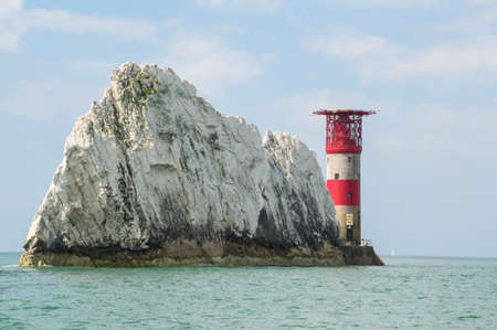 wight: The lighthouse at the end of The Needles on the Isle of Wight Stock Photo