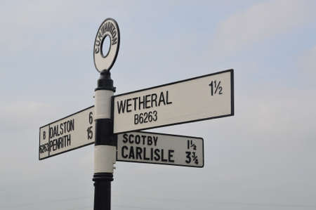 cumbria: vintage signpost at cumwhinton, lake district, cumbria
