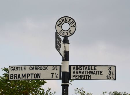 cumbria: vintage signpost at hornsby gate, lake district, cumbria