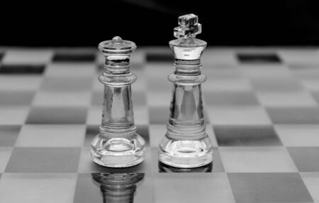 glass chess pieces on black and white