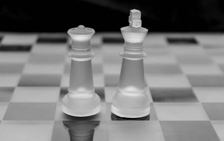 frosted glass chess pieces on black and white