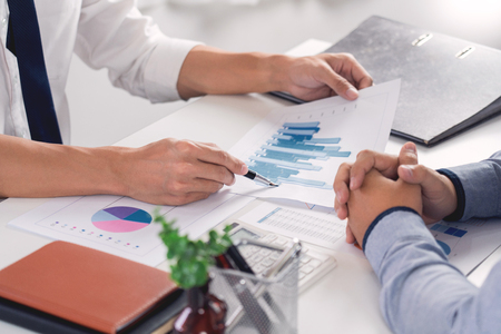 Business Corporate team brainstorming, Planning Strategy having a discussion Analysis investment researching with chart at office his desk documents and saving concept. Imagens