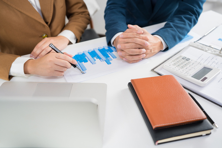 Business Corporate team brainstorming, Planning Strategy having a discussion Analysis investment researching with chart at office his desk documents and saving concept.