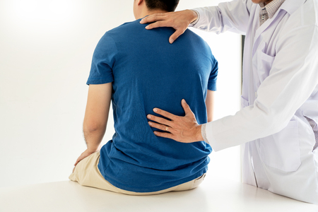 Physiotherapist working concept, Doctor and patient suffering or Chiropractor examining from back pain in clinic medical office