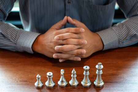 Business man moving chess game for business competition and team work concept. Stock Photo