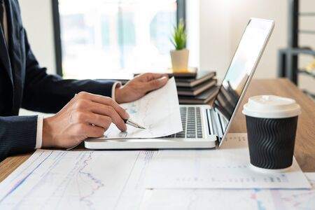 strategy analysis concept, Businessman working  financial Manager Researching Process accounting calculate analyse market graph data stock information review on the table in office Stock Photo