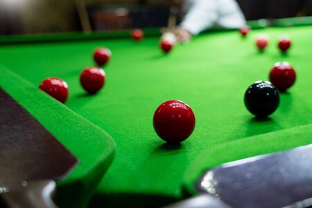 Game snooker billiards or opening frame player ready for the ball shot, athlete man kick cue on the green table in bar