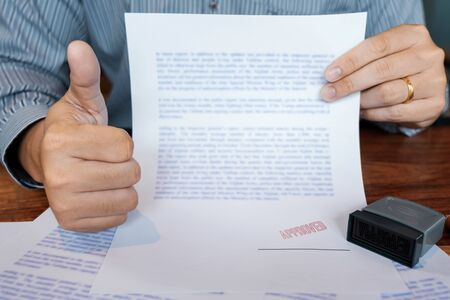 male point to signing business document for putting signature, fountain pen and approved stamped on a document, certificate contract agreement lawyer hand concept