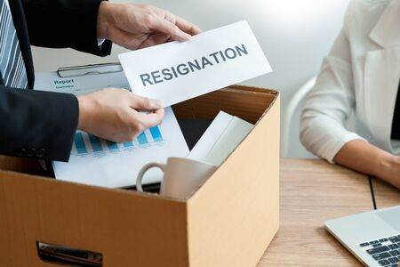 Businessman sending resignation letter to employer boss Including about resignation from positions and vacancies, changing and resigning from work concept for quit or change of job leaving the office, unemployment.