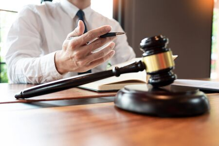 lawyer or judge business man working with paperwork agreement contract and gavel in Courtroom, Justice and Law firm Notary public concept.