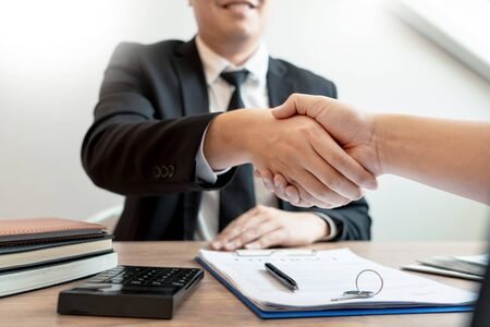 Customer and broker shake hands agreeing to buy new house at meeting after making sale purchase deal or finish buying or rental real estate with agent, Success deals concept.