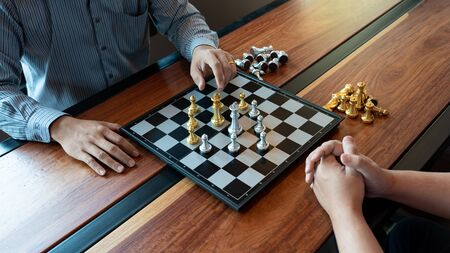 Business man moving chess game for business competition and team work concept. Banco de Imagens
