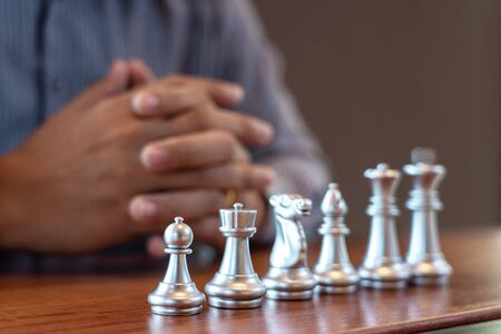 Business man moving chess game for business competition and team work concept. 写真素材