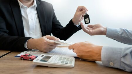agent broker man holding document showing an transportation contract form to client ownership  customer and salesman with car key
