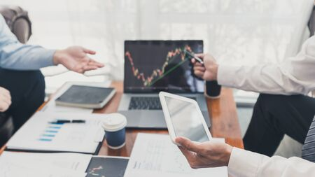 Working business man, team of broker or traders talking about forex on multiple computer screens of stock market invest trading financial graph charts data analysis.