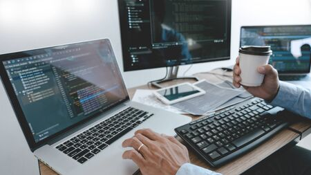 Programmer Typing Code on desktop computer, Developing programming and coding technologies concept