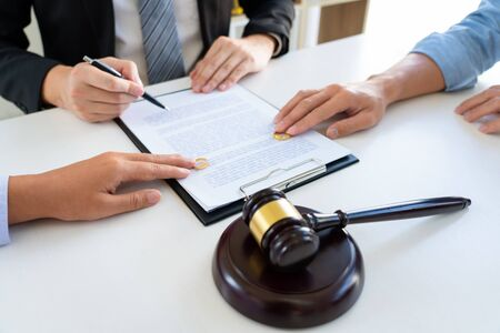 Judge gavel deciding on agreement prepared marriage divorce and Angry couple arguing telling their problems settlement, legal separation concept  Stock Photo
