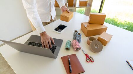 Delivery business Small and Medium Enterprise(SMEs) Workers packaging box In Distribution Warehouse home office for shipping to client