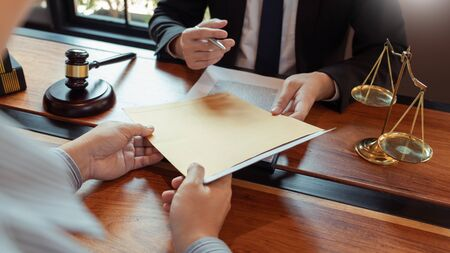 Male Notary lawyer or judge consult or discussing contract papers with Businessman client in office, Law and Legal services concept