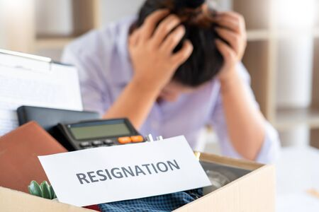 Businesswoman resigning from her job hold boxes and packing personal company for personal belongings. deciding resignation concept and changing work in future