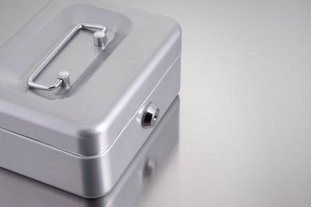 metal cash box on metallic background Stock Photo - 4179840
