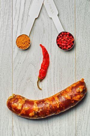 italian sausage: Italian sausage and spices smiley Stock Photo
