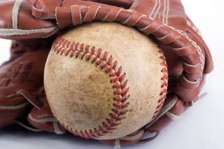 outfielders: Baseball with red stitching and outfielders glove (mitt) on a white background Stock Photo