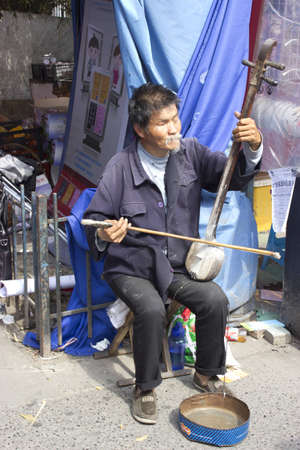 April 28th, 2012 - A blind begger in China playing an er hu for money  Editorial