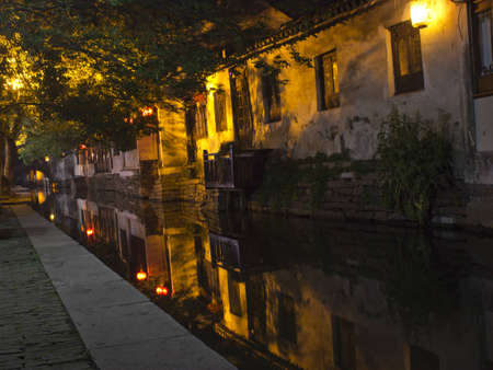 The canals that line the walkways in Zhouzhuang, China at night. Stock Photo