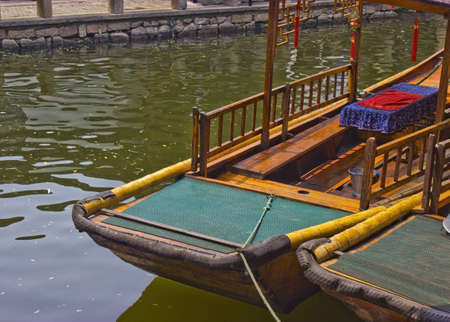 zhouzhuang: Gondolas in Zhouzhuang, China are an attraction for tourists as well as a way to get around the town for the locals