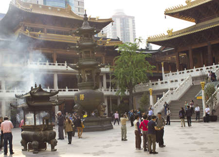 People Practicing Buddhism at Jing An Temple in Shanghai Editorial