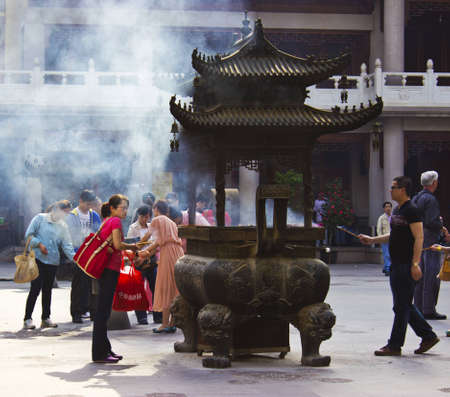 People Practicing Buddhism at Jing An Temple in Shanghai Stock Photo - 14142916