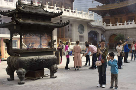 chinese philosophy: People Practicing Buddhism at Jing An Temple in Shanghai Editorial