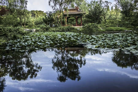 Chinese Pavilion reflected in a pond in the Ming Xiaoling Tomb in Nanjing China Stock Photo