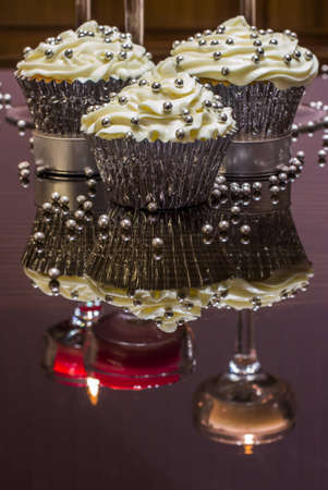White cupcake with silver decorations photo