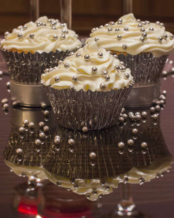 White cupcake with silver decorations Stock Photo - 14271458