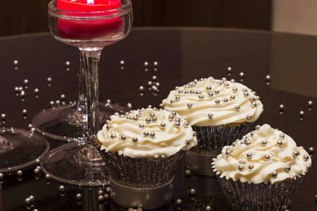 White cupcake with silver decorations
