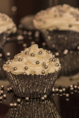 White cupcake with silver decorations Stock Photo - 14271462