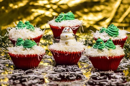 afternoon fancy cake: Christmas Cupcakes with a snowman and Christmas tree decorations