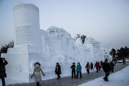 A massive snow sculpture at the Harbin Snow and Ice Festival in Harbin China 版權商用圖片 - 17491370