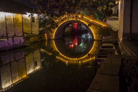 One of the ancient bridges in Zhouzhuang, China at night.