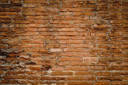 Brick wall is eroding orange Stock Photo