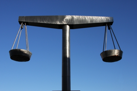 This stainless steel sculpture is in perfect balance, symbolizing that justice should always be balanced equally and fair, not swinging to and fro in one way or another  photo