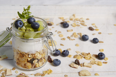 breackfast: fresh breackfast with cereals yogurt blueberry and kiwi