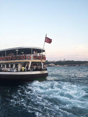 koy: Istanbul, Turkey, August 9, 2015 - Ferry is leaving from Karakoy station to Kadıkoy station in ıstanbul