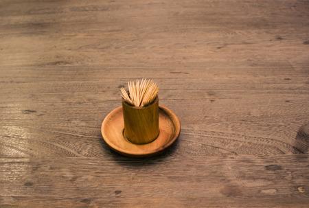 picks: tooth picks on wood table Stock Photo