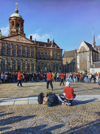 dam square: Amsterdam, Netherlands, October 29, 2015 - Street dancers put a show at Dam Square in Amsterdam Editorial