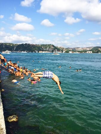 hottest: Istanbul, Turkey, August 9, 2015 - People swim in one of the hottest days of Summer on Bosphorus in Istanbul