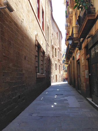 gotico: Barcelona, Spain, May 8, 2014 - One of the narrow streets in El Gotic district of Barcelona